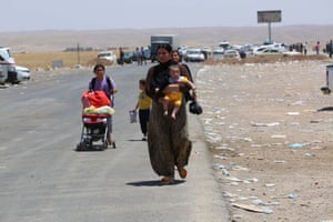 Thousands flee Iraq's Mosul due to the clashes between security forces and militants of Islamic State of Iraq and the Levant in Arbil, Iraq on June 11, 2014.