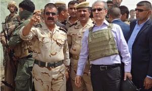 Kirkuk province's Kurdish governor Najim al-Din Omar Karim with a peshmerga commander