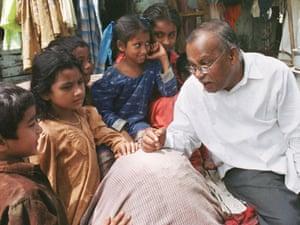 Jockin Arputham chats with children about school in the Madanpura slum in central Mumbai.