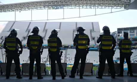 Military police officers keep watch during a Brazil training session ahead of the World Cup.
