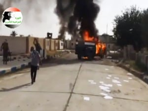 This video still shows militants on Al-Sharqat base north of Tikrit, Iraq, which was taken by fighters from ISIL, as soldiers and security forces abandoned their posts and yielded ground once controlled by U.S. forces.