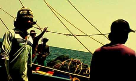Grabs from hidden camera footage exposing the modern slavery of shrimp prawn farming