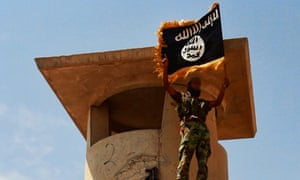 An ISIL militant posing with the trademark Islamists flag after they allegedly seized an Iraqi army checkpoint in the northern Iraqi province of Salahuddin. Jihadists are pushing toward Baghdad after capturing a town just hours to the north, as the US mulled air strikes in a bid to bolster Iraq's collapsing security forces. Photograph: AFP/Getty Images