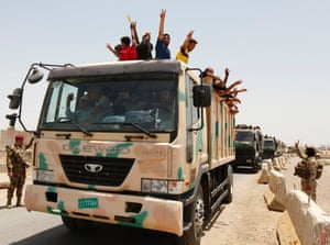 Volunteers who have joined the Iraqi Army to fight against the predominantly Sunni militants travel in an army truck in Baghdad.