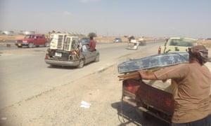 Looting at K1 Iraqi army base, west of Kirkuk. Photograph: Fazel Hawramy for the Guardian