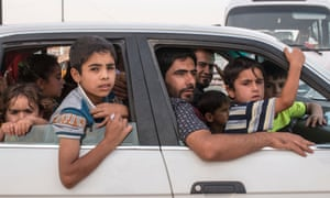 weds Children at a newly made refugee camp near Khazar check point.  As many as 500,000 people have been forced to flee the Iraqi city of Mosul after hundreds of Islamist militants took control.
