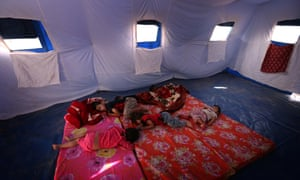 thurs Iraqi children fleeing violence in the northern Nineveh province sleep in a tent at a temporary camp in Aski Kalak, 40 kms West of Arbil, in the  Kurdistan region.