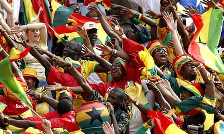 Ghanian fans singing in the crowd during the 2006 World Cup football fans soccer supporters ghana colourful supporters teams flags colourful soccer football scarves colours screaming supporting event match game soccer football FIFA fan fans support supporter supporters crowd sport sports sporting people germany man men male Ghana sing singing sings cheer cheering chant chanting crowds crowd ghanian