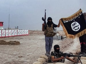 An image made available on the jihadist website Welayat Salahuddin on June 11, 2014 shows militants of the Islamic State of Iraq and the Levant (ISIL) posing with the trademark Jihadists flag after they allegedly seized an Iraqi army checkpoint in the northern Iraqi province of Salahuddin