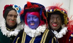 Spot the difference: a traditional Black Pete, an alternative Black Pete in blue and a new Black Pete. This new one doesn't have frizzy hair, is brown, has less red-coloured lips and doesn't wear golden earrings.