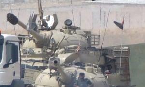 Kurdistan's Peshmerga forces transfer tanks on the borders of Kirkuk city iraq