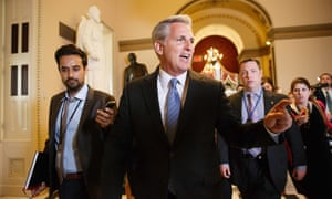 House Majority whip Kevin McCarthy leaves Speaker John Boehner's office, pursued by reporters, including the Guardian's Paul Lewis (left).
