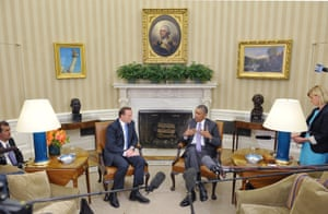 Barack Obama with Tony Abbott in front of the cameras in the Oval Office of the White House in Washington, DC.