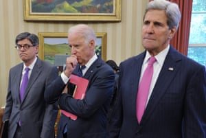 Their master's voice: US Treasury Secretary Jacob Lew, Vice President Joe Biden and Secretary of State John Kerry listen as US President Barack Obama speaks to the press during the meeting.