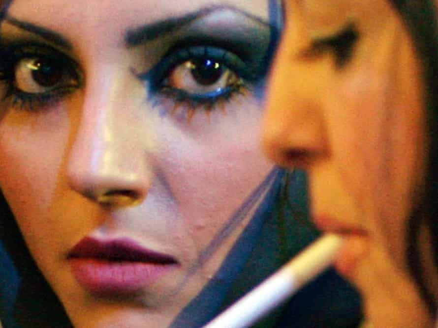 An Iranian woman smokes a cigarette as she rests in a coffee shop in Tehran in April 18, 2006