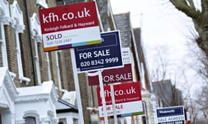 House 'for sale' signs. Bank of England warned of a rate hike sooner than expected
