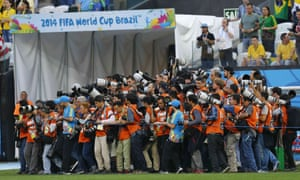 Photographers struggle to get to their positions ready to snap the two teams