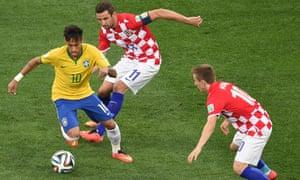 Brazil's forward Neymar races away with the ball.