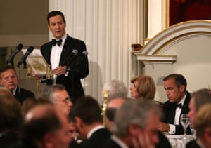 Chancellor of the Exchequer, George Osborne, speaks at the 'Lord Mayor's Dinner to the Bankers and Merchants of the City of London' as Mark Carney, Governor of the Bank of England, looks on at the Mansion House on June 12, 2014 in London,