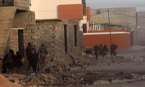 An image from a Jihadi website purports to show Isis militants taking position in the streets of the northern Iraqi city of Samarra on Tuesday.