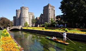 Man Punting Tourists Along The Westgate Gardens On The River Stour - cycling guide page 81
