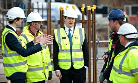 Chancellor George Osborne speaks to construction workers at a housing development in London