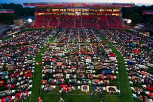 Sofa football: People sit on sofas as they watch the opening game of the 2014 World Cup