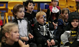 Pupils and teachers dress in fancy dress to celebrate Mexican festival, Day Of The Dead