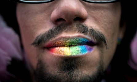 A man with rainbow-coloured lips at the gay pride parade in Sao Paulo, Brazil.