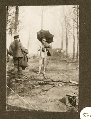 Behind the front lines after taking a dip: this officer carries an umbrella 'borrowed' from a billet in Ypres.