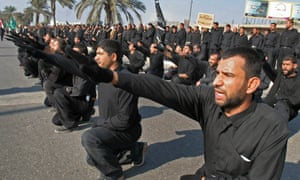 Members of the Mahdi army parade in the southern town of Basra in December 2005.
