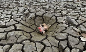 A doll lies on a hole in the dry soil of Los Laureles dam, southern Tegucigalpa, Honduras.