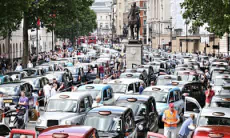 Taxis blockade Whitehall on June 11, 2014 in London, England