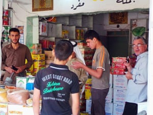 People shop for food and other supplies in the northern city of Mosul, Iraq, Friday.