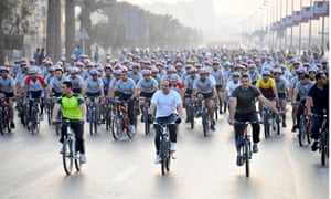 President Abdel Fattah al-Sisi leads a cycle ride in Cairo in a push to cut Egypt's fuel subsidies