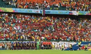 Players line up on the field before the Group B match.