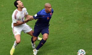 Sergio Busquets is elbowed in the chest by Nigel de Jong.