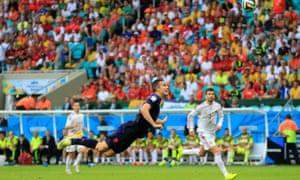 Robin van Persie scores a spectacular headed goal.