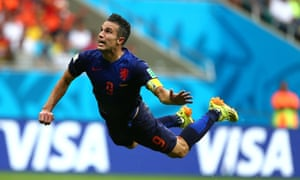 Robin Van Persie of Netherlands flies through the air to heads the equalising goal.