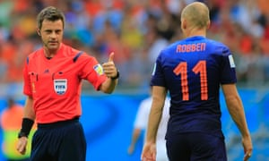 Referee Nicola Rizzoli from Italy with Arjen Robben.