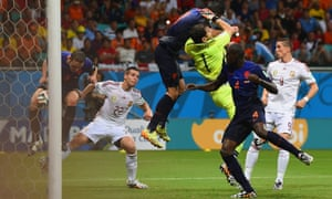 Stefan de Vrij of the Netherlands deflects the ball in for the third goal as Iker Casillas of Spain and Robin van Persie of the Netherlands collide.