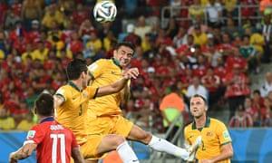Australia's forward Tim Cahill (C) jumps