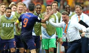 Robin van Persie celebrates scoring with the Holland coach Louis Van Gaal in the 2014 World Cup