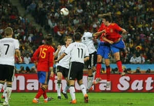 Carles Puyol of Spain heads the ball to score the opening goal during the 2010 World Cup