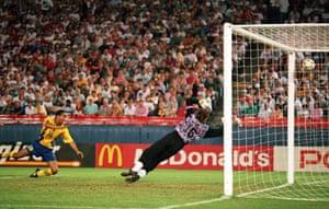 Martin Dahlin of Sweden watches as Russian keeper Dmitri Kharin fails to save his header
