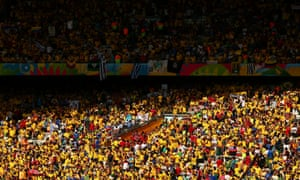 Fans in the sun prior to the start of the match between Colombia and Greece at Estadio Mineirao.