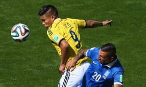 Jose Cholevas of Greece challenges Teofilo Gutierrez of Colombia.