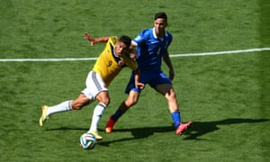 Teofilo Gutierrez of Colombia is challenged by Konstantinos Manolas of Greece.