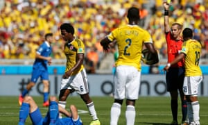 Colombia's Carlos Sanchez walks away after receiving a yellow card from referee Mark Geiger.