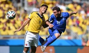 Greece's defender Vasilis Torosidis vies with Colombia's forward Teofilo Gutierrez.
